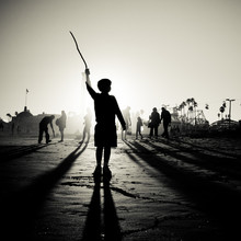 Boy With Stick At Beach