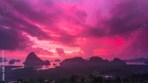 Wall Murals Candy pink Landscape of sunrise at limestone karsts in Phang-nga bay at sunrise. Unseen place of