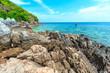 Kai island, Phuket, Thailand. Small tropical island with white sandy beach and blue transparent water of Andaman sea.