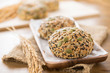 Multigrain mixed cereal seed healthy bread buns in wooden plate