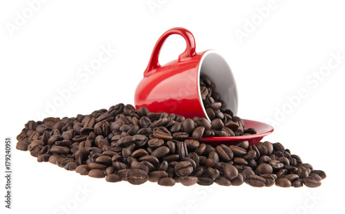 red cup and coffee grains isolated on white background close-up