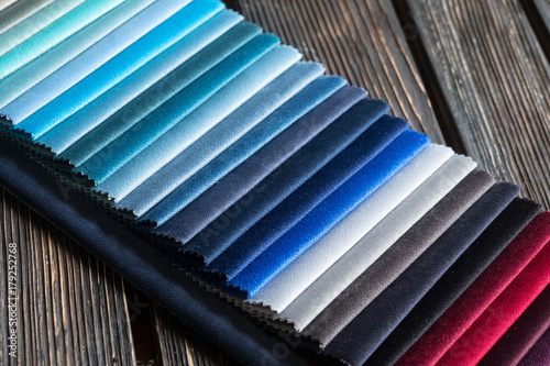 Fotobehang Stof Color samples of a fabric on a wood background
