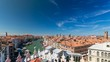 Top view on central busy canal in Venice timelapse, on both sides masterpieces of Venetian architecture