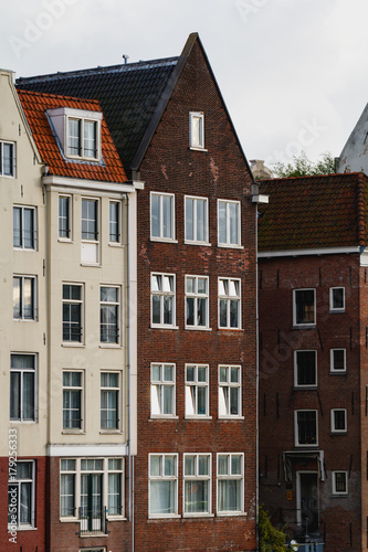 Foto op Plexiglas New York TAXI View of beautiful medieval houses in Amsterdam, Holland, Europe.
