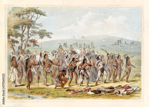 Group of native indians keep in training with their arches on a grassland Wallpaper Mural