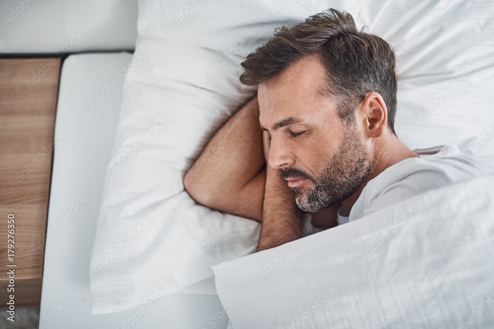 Fototapety, obrazy: Man sleeping peacefully in bed