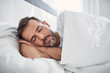 canvas print picture - Peacefulness concept. Handsome man sleeping in bed