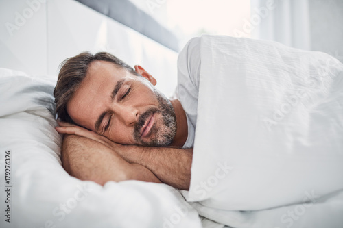 Fotografie, Obraz Peacefulness concept. Handsome man sleeping in bed