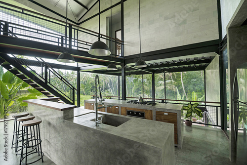 Modern Minimalist Kitchen In Contemporary Design House With Glass Facade  Surrounded By Lush Tropical Garden