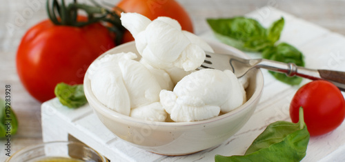 Italian cheese mozzarella nodini with tomatoes and herbs