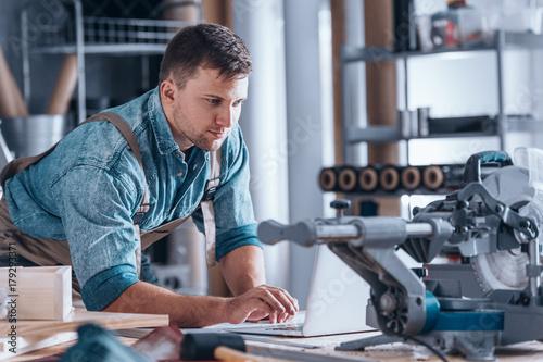 Creative furniture craftsman using technology Wallpaper Mural