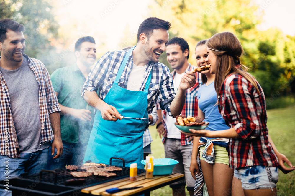 Fototapety, obrazy: Happy friends enjoying barbecue party