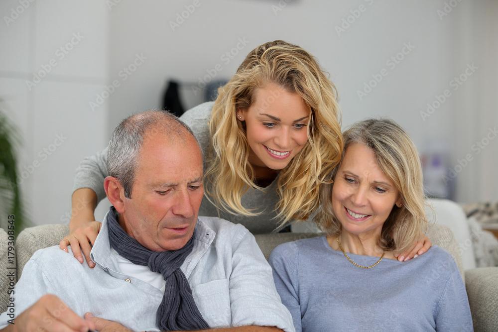 Fototapeta aged family having fun together