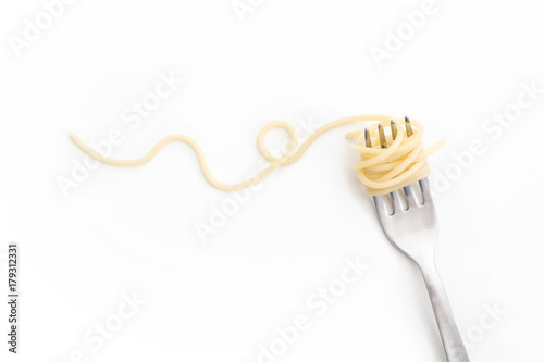 Plain cooked spaghetti pasta on fork with swirl, on white background.