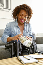 Young Woman With Jar Of Money ...