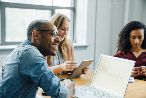 Business people using technology in meeting