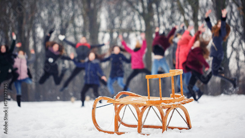 Fotografia  Children sled on snow stand