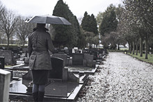 Widow Woman Visiting Graveyard...