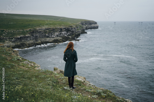 Foto op Canvas Fantasie Landschap Caucasian woman standing near ocean