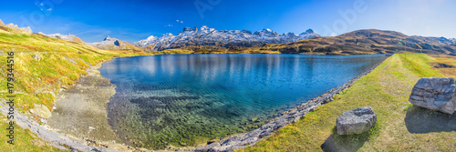 Poster Lavender Crystal clear Melchsee and Swiss Alps panorama from Melchsee Frutt, Obwalden, Switzerland, Europe