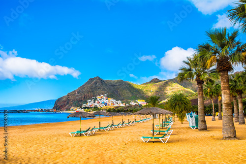 Amazing view of beach las Teresitas with yellow sand, umbrellas, longues and palm trees Fototapeta