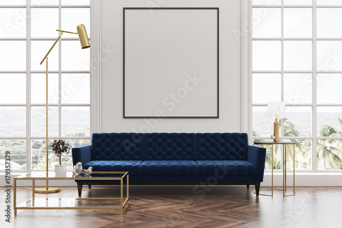 Fotografía  White living room, blue sofa, poster