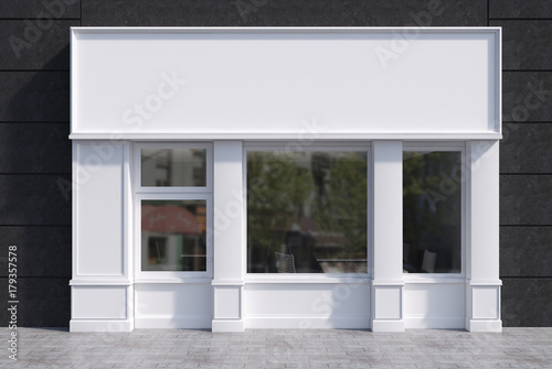 White and black cafe facade with a poster