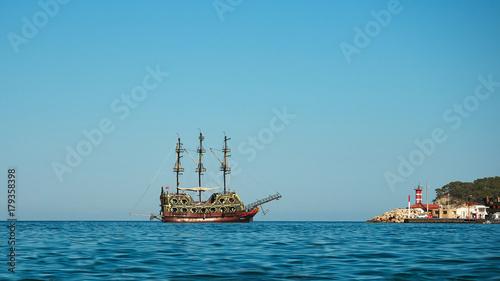 Canvas Prints Ship Beautiful retro sailing ship on the high seas. View from coastline