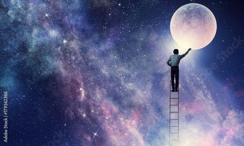 Fotografía  Man that get moon . Mixed media