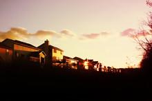 Evening Sun Setting On A Row O...