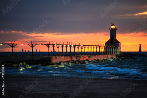 Fotografie, Obraz  Michigan City, Indiana lighthouse with Chicago skyline on the horizon