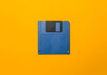 Blue Diskette On Yellow Background