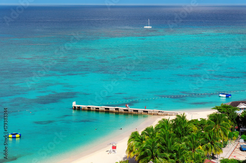 Aerial view on beautiful Caribbean beach and pier in Montego Bay, Jamaica island.