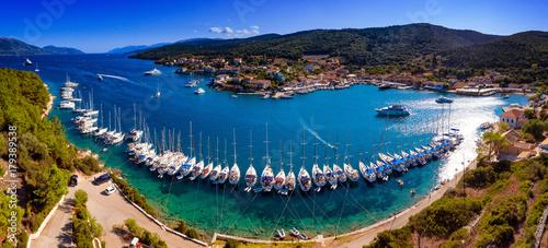 Yachts ancored in harbour in Fiskardo Kefalonya bay in Greece