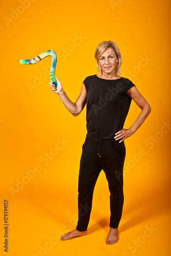 woman posing with a boomerang Wallpaper Mural