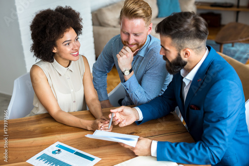 Valokuva  Young couple talking to estate agent