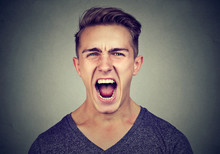 Portrait Of An Angry Man Screaming
