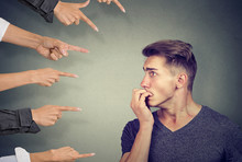 Anxious Man Judged By Different People. Concept Of Accusation Of Guilty Guy.