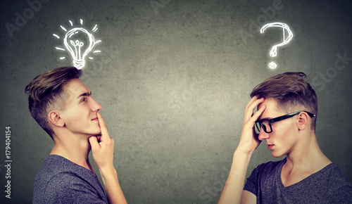 Photo Two men thinking one has a question another solution with light bulb above head