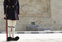 Greek Traditional Soldier  Front Of The Tomb Of The Unknown Soldier In Athens, Greece.