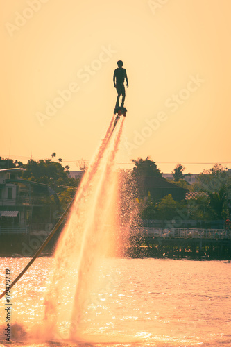 Recess Fitting Water Motor sports NONTHABURI, THAILAND - February 27 2015: Silhouette and vintage color styl of showing flyboard on Chaophya river during Chinese new year celebrations on February 27, 2015 Nonthaburi, Thailand.