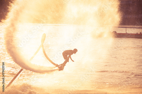 Photo Stands Water Motor sports Silhouette and vintage color styl showing flyboard on Chaophya river