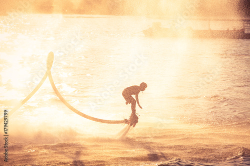 Poster Water Motor sports Silhouette and vintage color styl showing flyboard on Chaophya river