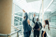 Happy business team giving high fives gesture they laugh and cheer their success