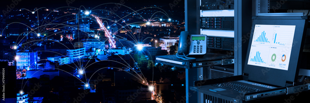 Fototapeta Management and monitoring monitor in data center and connectivity lines over night city background, smart city concept