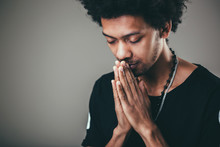 Man Praying Hands Clasped Hoping For Best Asking For Forgiveness Or Miracle