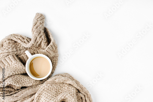 Cup of coffee  with warm plaid. Copy space. Flat lay, top view