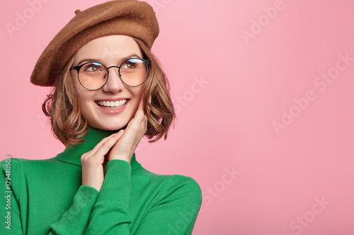 Fotografie, Tablou Pleased beautiful woman has good mood, dreams about something pleasant, imagines