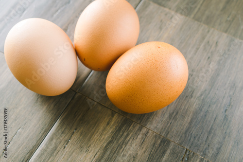 Brown eggs on wood background