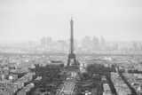 Fototapeta Paryż - View of the streets of Paris from the heights. Travel through Europe. Attractions in France. Cloudy Paris. Clouds in the sky. Eiffel Tower